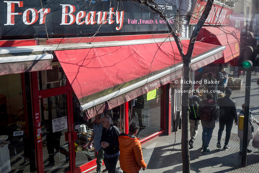 An awning for the beauty bar Passion For Beauty is broken and twisted on the Walworth Road in Southwark, on 27th February 2019, in London, England.