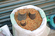 Peppercorns for sale at the early morning market on the streets of Patan, Nepal.
