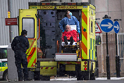 **Face pixelated to hide identity of patient**<br /> © Licensed to London News Pictures.09/02/2021, London,UK. A patient arrives at the Royal London Hospital in east London during a snow shower, as the third national lockdown continues and hospitals are struggling to cope with the number of admissions. Photo credit: Marcin Nowak/LNP
