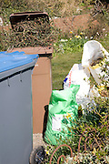 Garden refuse bins for composting