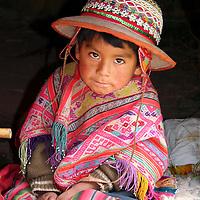 Americas, South America, Peru, Cusco. Young Peruvian boy in traditional dress.