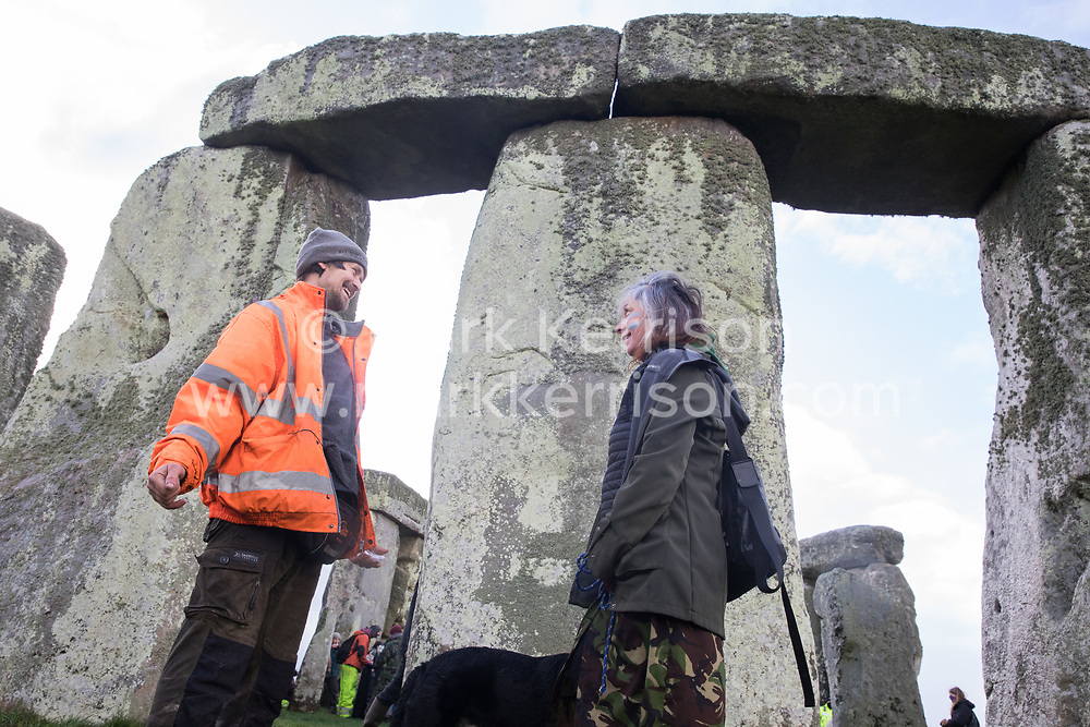 Salisbury, UK. 5th December, 2020. Dan Hooper (l), better known as roads protester Swampy in the 1990s, joins over one hundred people including local residents, climate and land justice activists and pagans at a Mass Trespass at Stonehenge. The trespass was organised in protest against the approval by Transport Secretary Grant Shapps of a £1.7bn project for a two-mile tunnel beneath the World Heritage Site and a further eight miles of dual carriageway for the A303, as well as the government's £27bn Road Investment Strategy 2 (RIS2).