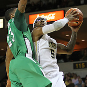 Central Florida guard Marcus Jordan (5) shoots past Marshall guard Shaquille Johnson (23) during a Conference USA NCAA basketball game between the Marshall Thundering Herd and the Central Florida Knights at the UCF Arena on January 5, 2011 in Orlando, Florida. Central Florida won the game 65-58 and extended their record to 14-0.  (AP Photo/Alex Menendez)