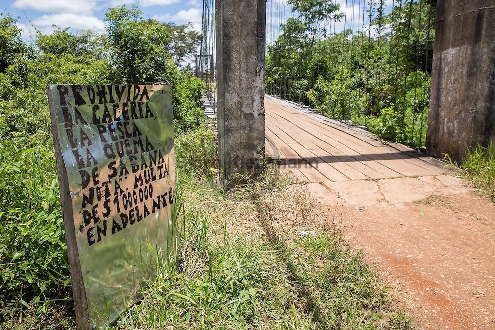 La Tunia, Meta, Colombia - 15.09.2016        <br /> <br /> The village La Tunia is located in a Colombian area which is controlled by the marxist guerrilla FARC. At the entrance of the village is road sign with the local prohibitive rules.<br /> <br /> Das Dorf La Tunia liegt in dem Teil Kolumbiens der von der marxistischen Guerilla FARC kontrolliert wird. Bereits an der Zufahrtsstrasse befindet sich ein Schild, welches auf lokale Verbote die Strafen bei Verstoeßen aufmerksam macht. <br /> <br /> Photo: Bjoern Kietzmann