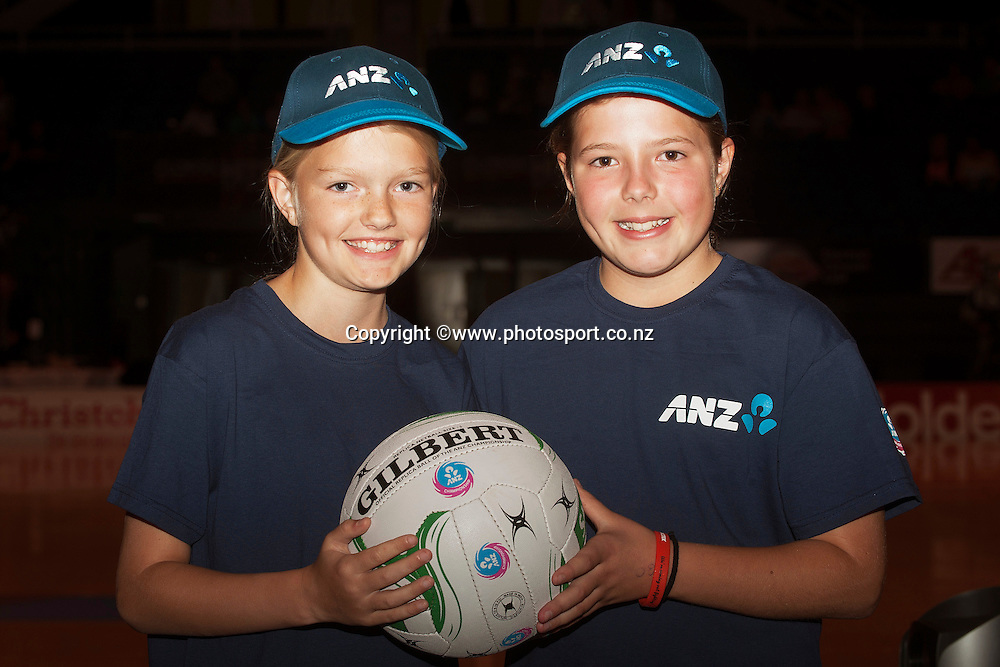 ANZ Future Captains competition winners, Maddison Foster, 10 years old and Phoebe Finnie, 10 years old with Casey Kopua captain of the Magic before ANZ Championship Netball between Mainland Tactix v WBOP Magic, held at CBS Arena, Christchurch. 01 March 2014 Photo: Joseph Johnson/www.photosport.co.nz