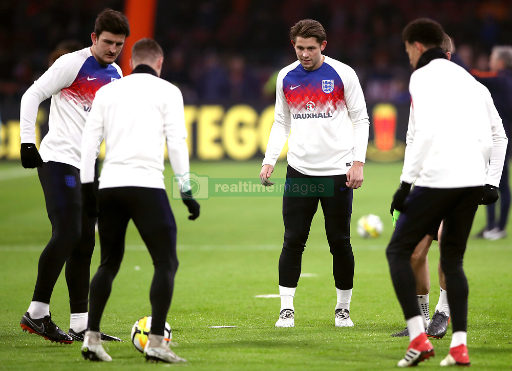 England's James Tarkowski (centre) warms up with team-mates Dele Alli (right) and Harry Maguire (left)