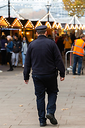 DAILY MAIL: A police officer strolls through the crowds at the Southbank Christmas Market adjacent to the London Eye in London. London, November 16 2018.