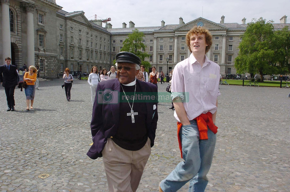 Former Archbishop of Cape Town, Dr Desmond Tutu strolls through the grounds of Trinity College Dublin with President of the Philosophical Society, Paddy Cosgrave, before the Nobel Peace Prize winner was made an honorary fellow of the Philosophical Society.