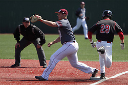 26 April 2015:  Sean Beesley runs to first attempting to beat the throw to Justin Paulsen during an NCAA Division I Baseball game between the Missouri State Bears and the Illinois State Redbirds in Duffy Bass Field, Normal IL