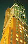 A skyscraper at night with illuminated windows New York