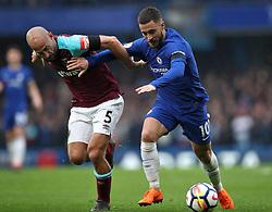 West Ham United's Pablo Zabaleta (left) and Chelsea's Eden Hazard battle for the ball