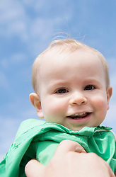 Portrait small baby boy smiling sunny day