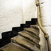A section of the winding staircase of the Belfry of Bruges. The Belfry (or Belfort) is a medieval bell tower standing above the Markt in the historic center of Bruges. The first stage was built in 1240, with further stages on top built in the late 15th century. Visitors can climb some of the 366 steps to the top of the tower.