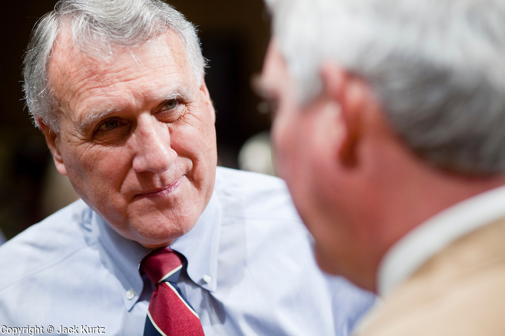 Apr. 20, 2009 -- PHOENIX, AZ: US Sen JON KYL (R-AZ) left, talks to LARRY DEVER, the sheriff of Cochise County, a rural county in southern Arizona on the US/Mexico border, before a Senate committee hearing in Phoenix Monday. The US Senate Committee on Homeland Security and Government Affairs, chaired by Sen. Joe Lieberman (Ind-CT), held a hearing about local perspectives on border violence in the Phoenix City Council chambers in Phoenix, AZ, Monday.   Photo by Jack Kurtz