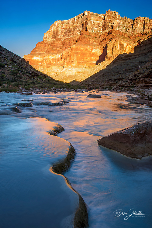 Little Colorado River- mineral-laden water flowing over traverrtine terraces at dawn, Grand Canyon National Park, Arizona, USA