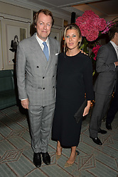 TOM PARKER BOWLES and his wife SARA at a party hosted by Ewan Venters CEO of Fortnum & Mason to celebrate the launch of The Cook Book by Tom Parker Bowles held at Fortnum & Mason, 181 Piccadilly, London on 18th October 2016.