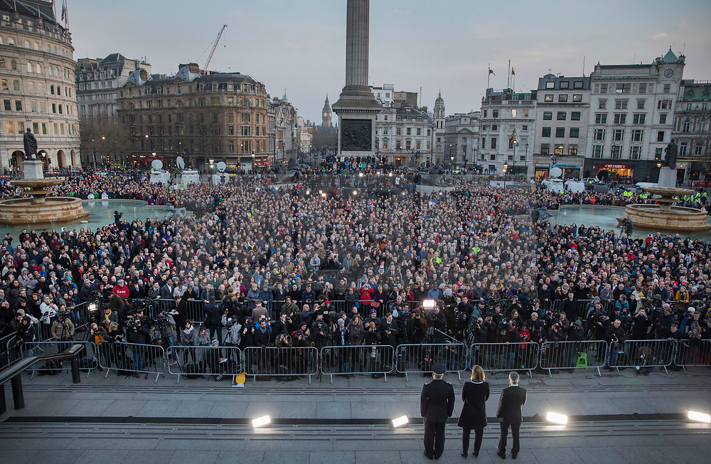 © Licensed to London News Pictures.23/03/2017.London, UK.  London Mayor, Sadiq Khan, Home Secretary, Amber Rudd and acting Met Police Commissioner, Craig Mackey stand on stage as people gather in Trafalgar Square for a vigil to remember the victims of Wednesday's terror attack.  A lone terrorist killed 4 people and injured several more, in an attack using a car and a knife. The attacker managed to gain entry to the grounds of the Houses of Parliament, killing one police officer.Photo credit: Peter Macdiarmid/LNP