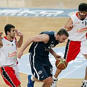 Anadolu Efes's Dusko Savanovic (C) during their Turkish Basketball League match Anadolu Efes between Bandirma Kirmizi at Sinan Erdem Arena in Istanbul, Turkey, Saturday, December 24, 2011. Photo by TURKPIX