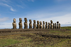 Chile, Easter Island: Array of statues or moai on a platform or ahu at Ahu Tongariki, near the quarry Rano Raruku.  This is the largest array of moia on Easter Island, consisting of 15 moai..Photo #: ch244-33848.Photo copyright Lee Foster www.fostertravel.com lee@fostertravel.com 510-549-2202