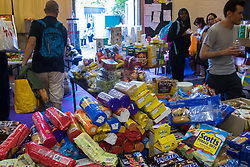 London, June 14th 2017. As fire rages through a residential tower block, Grenfell Tower, in Kensington, West London, local residents show their generosity as well-wishers pour into the Maxilla Social Club with clothing, food, water and blankets for the residents of the block who will have lost everything.