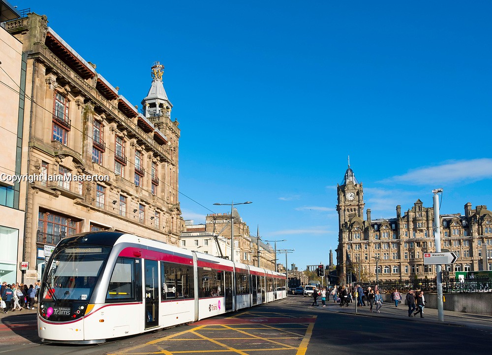 View along Princes street with tram and Balmoral Hotel visible in Edinburgh , Scotland, United Kingdom.