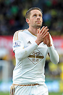 Swansea's Gylfi Sigurdsson applauds the fans at the end of the match. Barclays Premier league match, Swansea city v Norwich city at the Liberty Stadium in Swansea, South Wales on Saturday 5th March 2016.<br /> pic by  Carl Robertson, Andrew Orchard sports photography.