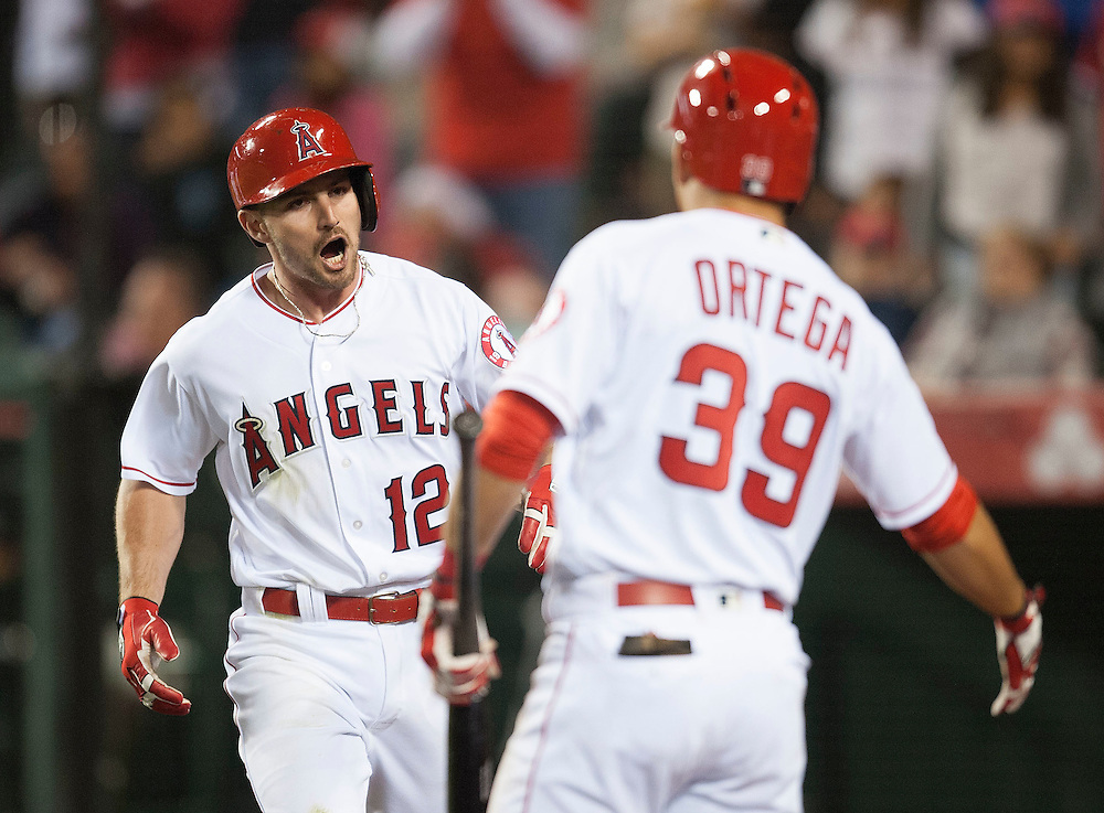 The Angels' Johnny Giavotella celebrates after his three run home run in the fifth inning against the Kansas City Royals Tuesday night at Angel Stadium.<br /> <br /> ///ADDITIONAL INFO:   <br /> <br /> angels.0427.kjs-pre  ---  Photo by KEVIN SULLIVAN / Orange County Register  --  4/26/16<br /> <br /> The Los Angeles Angels take on the Kansas City Royals Tuesday at Angel Stadium.<br /> <br /> <br />  4/26/16