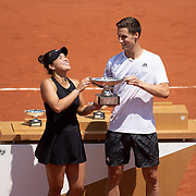 PARIS, FRANCE June 10. Desirae Krawczyk of the United States and Joe Salisbury of Great Britain with the mixed doubles winners trophy after their victory on Court Philippe-Chatrier during the 2021 French Open Tennis Tournament at Roland Garros on June 10th 2021 in Paris, France. (Photo by Tim Clayton/Corbis via Getty Images)