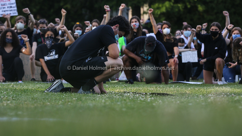 (6/3/20, HOPEDALE, MA) Hopedale High School graduate and march organizer Jackson Tahmoush kneels for nine minutes during a Black Lives Matter march in Hopedale on Wednesday. [Daily News and Wicked Local Photo/Dan Holmes]