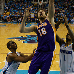 April 28, 2011; New Orleans, LA, USA; Los Angeles Lakers power forward Pau Gasol (16) shoots over New Orleans Hornets small forward Trevor Ariza (1) and point guard Chris Paul (3) during the fourth quarter in game six of the first round of the 2011 NBA playoffs at the New Orleans Arena. The Lakers defeated the Hornets 98-80 to advance to the second round of the playoffs.   Mandatory Credit: Derick E. Hingle