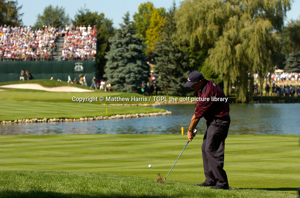 Phil MICKLESON (USA) hits his second shot at 16th par 4 into the water V Sergio GARCIA (EUR) during final day Singles of the Ryder Cup Matches 2004,Oakland Hills (South Course),Bloomfield,Michigan,USA.