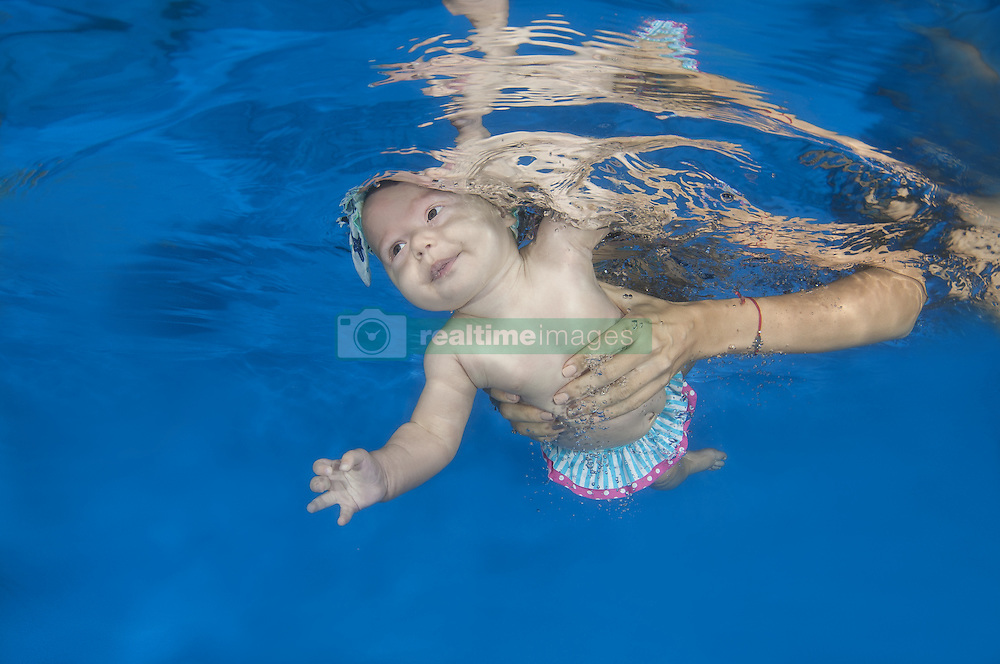 September 6, 2016 - Odessa, Ukraine - 4 months infant girl learning to swim underwater in waterbaby class in the pool (Credit Image: © Andrey Nekrasov/ZUMA Wire/ZUMAPRESS.com)