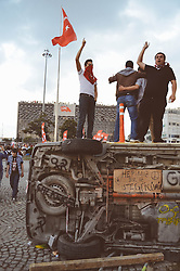 © Licensed to London News Pictures. 02/06/2013. Istanbul, UK Images of protesters and damage around Taksim Square in Istanbul 2nd June 2013. Damage to shops and properties occurred on Saturday evening after clashes with police and protesters. The protesters smashed ATM's, took over buildings and defaced property. Many of the protesters broke down barriers to a building site that had been sealed off for several months. Photo credit : Jamie Bowlby-Whiting/LNP