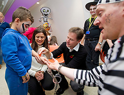 © London News Pictures. 31/10/2013 . London, UK.  Deputy Prime Minister NICK CLEGG and his wife MIRIAM GONZALEZ DURANTEZ talk to RIAN CAREY (left aged 5) while meeting children, parents and volunteers at the Great Ormond Street Hospital annual Halloween party.  Photo credit : Ben Cawthra/LNP
