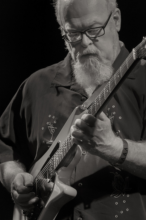 Steve Cooley playing the electric guitar at Headliners Music Hall in Louisville, Kentucky.