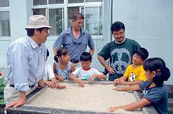 Kazuyoshi Omuta, J. Nichols & Dr. Naoki Kamezaki With Students Learning About Nesting Sea Turtles