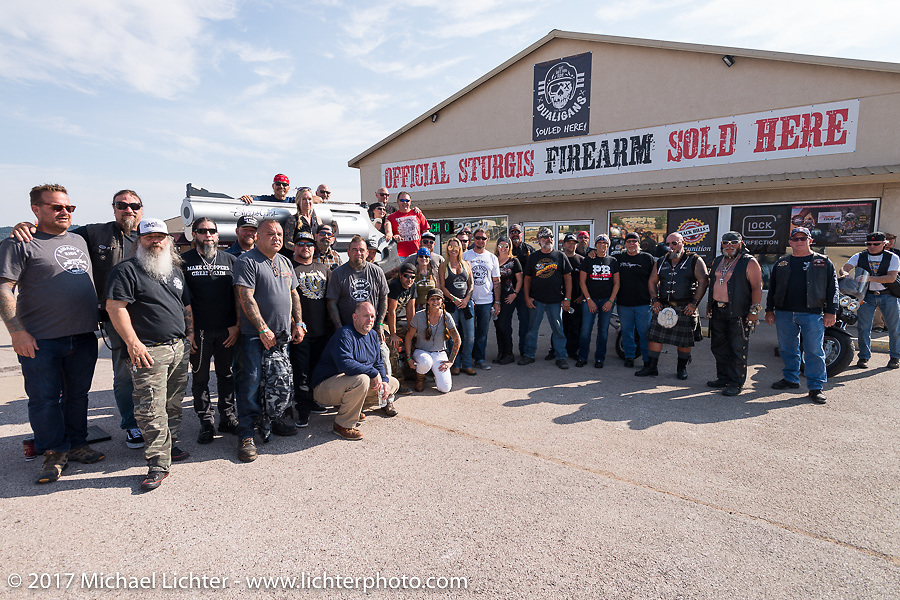 Group photo at Aiden's Ride in Sturgis to raise money for the nonprofit to help raise awareness and find a cure for ALD (Adrenoleukodystrophy)Annual Sturgis Black Hills Motorcycle Rally. SD. USA. Tuesday August 8, 2017. Photography ©2017 Michael Lichter.