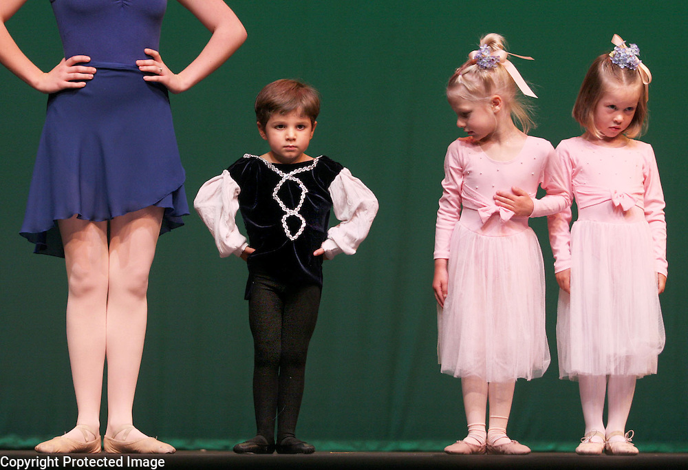 Caetano Lepore-Gordinno puts on his game face as he joins Clara Perotti and Alona Crago on stage with their ballet teacher Alexis Bartlow as the perform in Motion Pacific's Spring Showcase.<br /> Photo by Shmuel Thaler <br /> shmuel_thaler@yahoo.com www.shmuelthaler.com