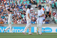 England's Mark Wood and Wicketkeeper Jos Buttler of England after the 200 is up during the 3rd day of the Investec Ashes Test match between England and Australia at the Oval, London, United Kingdom on 22 August 2015. Photo by Phil Duncan.