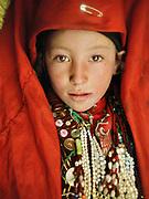 "Portrait of a princess: Tella-bu, daughter of Abdul Rashid Khan, inside her father's yurt. Kara Jelgha (""black valley"") summer camp. The campment of Abdul Rashid Khan, the ""king"" of the Kyrgyz.<br /> <br /> Adventure through the Afghan Pamir mountains, among the Afghan Kyrgyz and into Pakistan's Karakoram mountains. July/August 2005. Afghanistan / Pakistan."
