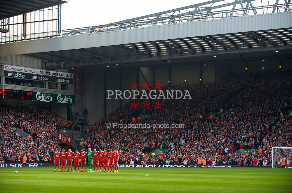 LIVERPOOL, ENGLAND - Sunday, March 22, 2009: Liverpool's supporters and players observe a minute's silence in memory of Club Secretary Bryce Morrison, who passed away on Saturday morning, before the Premiership match against Aston Villa at Anfield. L-R: Alvaro Arbeloa, Dirk Kuyt, Jamie Carragher, Javier Mascherano, captain Steven Gerrard MBE, goalkeeper Pepe Reina, Martin Skrtel, Fernando Torres, Xabi Alonso, Fabio Aurelio, Albert Riera. (Photo by David Rawcliffe/Propaganda)