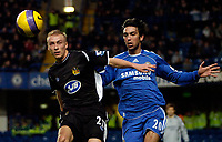 Photo: Ed Godden/Sportsbeat Images.<br />Chelsea v Wigan Athletic. The Barclays Premiership. 13/01/2007. Wigan's David Cotterill (L), holds off Paulo Ferreira.