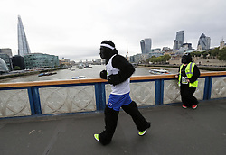 Participants in fancy dress crossing Tower Bridge, London, during The Great Gorilla Run.