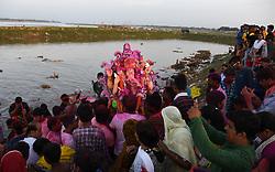 September 5, 2017 - Allahabad, Uttar Pradesh, india - Hindu Devotee Immerse Elephant headed Lord Ganesha's idol in a pond near River Ganga on the occasion of Anant Chaturdasi festival celebration. (Credit Image: © Prabhat Kumar Verma via ZUMA Wire)