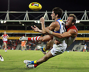 of the Swans tackles Michael Rischitelli of the Suns during the 2013 NAB Cup round 03 match between the Sydney Swans and the Gold Coast Suns at Blacktown International Sportspark, Sydney. (Photo: Craig Golding/AFL Media)
