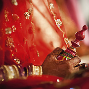 One of the accessories that distinguishes the Bengali bride from that of any other community is the 'kajal-lata' (kohl stick) and the 'gaachh kouto' (a wooden can that is supposed to contain sacred vermillion) that she carries in her hand throughout the wedding ceremonies.