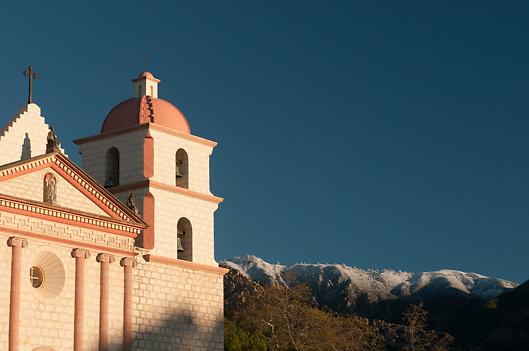 Historic Santa Barbara Mission and snowcapped mountains