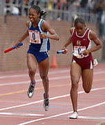 Tasha Stanley of Eleanor Roosevelt High (Md.) and Bobby-Gaye Wilkins of Holmwood Tech of Jamaica duel on the homestretch of the Championship of America girls 4 x 800-meter relay in the 113th Penn Relays at the University of Pennsylvania's Franklin Field in Philadelphia, Pa. on Friday, April 27, 2006. Roosevelt won in 8:51.19 and Holmwood Tech was second in 8:51.23.