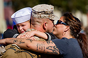 Navy Corpsman Aaron Spaulding gets a warm welcome from his son Wesley, 6, and his wife Lety as he returns to Camp Pendleton, CA, after being deployed to Afghanistan's Helmand Province with the Marine Expeditionary Brigade.