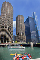 Kayakers on a urban adventure on the Chicago River in front of Marina Towers